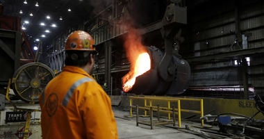 In this June 28, 2018 photo, senior melt operator Randy Feltmeyer watches a giant ladle back away after pouring red-hot iron into a vessel in the basic oxygen furnace as part of the process of producing steel at the U.S. Steel Granite City Works facility