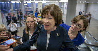 In this Aug. 21, 2018, file photoSen. Susan Collins, R-Maine, speaks with reporters on an escalator at the Capitol in Washington.