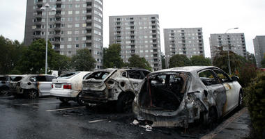 Burned cars parked at Frolunda Square in Gothenburg, Tuesday, Aug. 14, 2018.