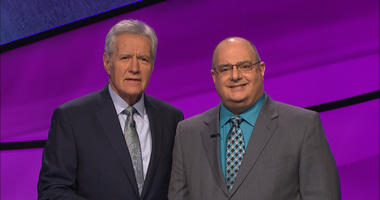 "Phil Ricciardi poses with Alex Trebek on the set of ""Jeopardy!"""