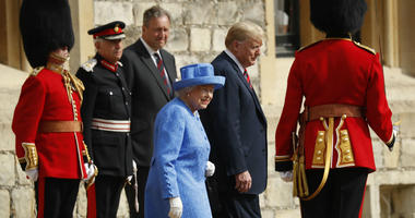 Queen Elizabeth II and President Donald Trump walk together to inspect the Guard of Honour at Windsor Castle in Windsor, England.