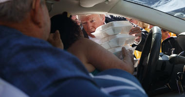 President Donald Trump hands out prepackaged meals at Temple Baptist Church in an area impacted by Hurricane Florence, Wednesday, Sept. 19, 2018, in New Bern, N.C.