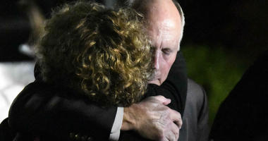 UNC Charlotte Chancellor Philip DuBois receives a hug after a news conference regarding a deadly shooting on the campus earlier in the day, Tuesday, April 30, 2019, in Charlotte, N.C.