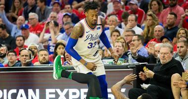 Philadelphia 76ers forward Robert Covington (33) fouls Boston Celtics guard Marcus Smart (36).