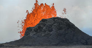 Lava shoots in the air out of a fissure in the ground in the Leilani Estates subdivision.