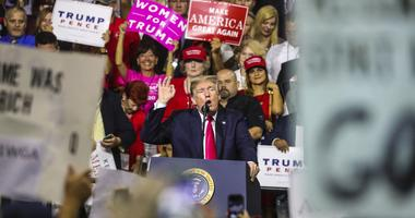 President Donald Trump gets the crowd cheering before leaving the stage during the President Donald J. Trump s Make America Great Again Rally at the Florida State Fair Grounds Expo Hall.