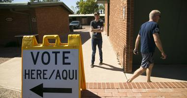 August 28, 2018; Scottsdale, AZ, USA: Roger Baker (right) of Scottsdale, walks back to his vehicle after voting for the primary, at the polling place at the Paiute Neighborhood Center.