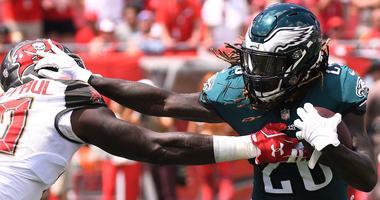 Philadelphia Eagles running back Jay Ajayi (26) tries to get past Tampa Bay Buccaneers defensive lineman Jason Pierre-Paul (90) in the first half at Raymond James Stadium on Sept. 16, 2018.