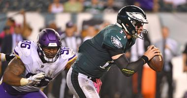 Philadelphia Eagles quarterback Carson Wentz (11) scrambles away from Minnesota Vikings defensive tackle Tom Johnson (96) during the fourth quarter at Lincoln Financial Field.