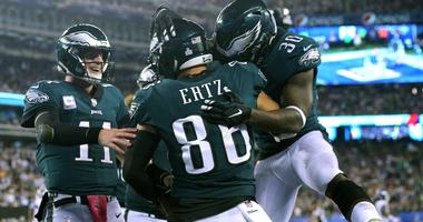 Philadelphia Eagles tight end Zach Ertz (86) celebrates with quarterback Carson Wentz (11) and running back Corey Clement (30) after making a touchdown catch against the New York Giants during the second quarter at MetLife Stadium, Oct. 11, 2018.