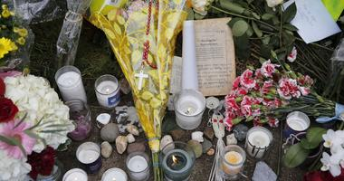 A memorial on the sidewalk on Wilkins Avenue near the Tree of Life Synagogue.