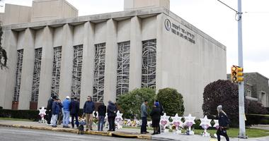 October 29, 2018; Pittsburgh, PA, USA; Mourners visit the Tree of Life Congregation Synagogue in the Squirrel Hill neighborhood of Pittsburgh Monday, October 29, 2018, after 11 were killed and six other people were wounded Saturday.