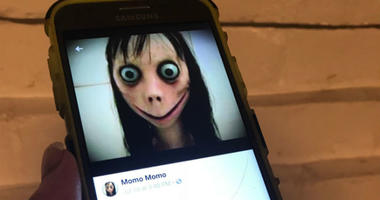"""The avatar of """"Momo"""" as seen on Facebook. Momo Challenge avatar."""