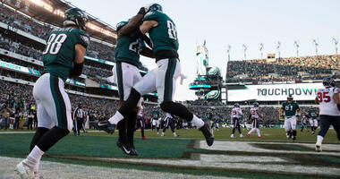 Dec 23, 2018; Philadelphia, PA, USA; Philadelphia Eagles tight end Zach Ertz (86) reacts with running back Wendell Smallwood (28) ad tight end Dallas Goedert (88) after scoring a touchdown against the Houston Texans during the fourth quarter at Lincoln Fi