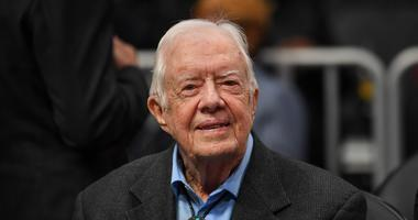 Former U.S. President Jimmy Carter is at a game between the Atlanta Hawks and the New York Knicks at State Farm Arena.