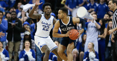 Mar 9, 2019; Newark, NJ, USA; Villanova Wildcats guard Phil Booth (5) shields the ball from Seton Hall Pirates guard Myles Cale (22) during the seance half at Prudential Center.