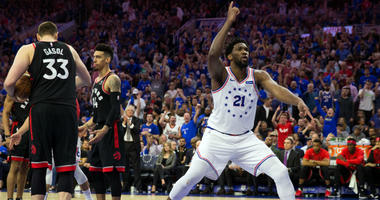 May 2, 2019; Philadelphia, PA, USA; Philadelphia 76ers center Joel Embiid (21) reacts in front of Toronto Raptors center Marc Gasol (33) and guard Danny Green (14) after a score in game three of the second round of the 2019 NBA Playoffs at Wells Fargo Cen