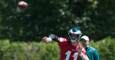 Jun 11, 2019; Philadelphia, PA, USA; Philadelphia Eagles quarterback Carson Wentz (11) throws the ball in front of quarterbacks coach Press Taylor during Minicamp at Novacare Complex.