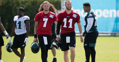 Jul 26, 2019; Philadelphia, PA, USA; Philadelphia Eagles quarterback Carson Wentz (11) and quarterback Nate Sudfeld (7) during training camp at Novacare Complex.