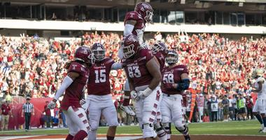 Sep 28, 2019; Philadelphia, PA, USA; Temple Owls offensive lineman Vincent Picozzi (76) lifts up Temple Owls running back Re'Mahn Davis (20) to celebrate his touchdown.