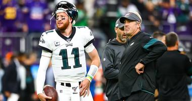 Philadelphia Eagles quarterback Carson Wentz and head coach Doug Pederson talk before the start of a game against the Minnesota Vikings at U.S. Bank Stadium.