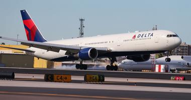 A Delta Airlines 767 airplane touches down.