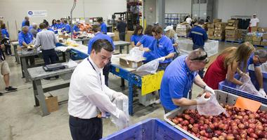 Jul 21, 2016; Cleveland, OH, USA; Arizona delegates help out to pack food bags at Greater Cleveland Food Bank as a part of Arizona delegation community project during the Republican National Convention.