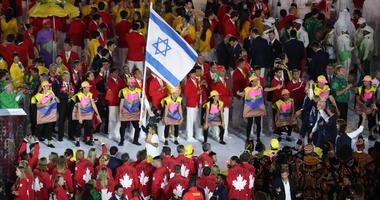 Neta Rivkin of Israel holds her nation's flag as her fellow Olympians follow during the opening ceremonies for the Rio 2016 Summer Olympic Games.