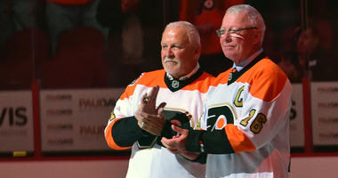 Oct 27, 2016; Philadelphia, PA, USA; Philadelphia Flyers greats goalie Bernie Parent (1) and Bobby Clarke (16) on ice during ceremony before game against Arizona Coyotes at Wells Fargo Center.