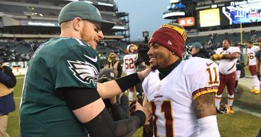 Philadelphia Eagles quarterback Carson Wentz speaks with Washington Redskins wide receiver DeSean Jackson.