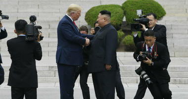 President Donald Trump walks to the North Korean side of the border with North Korean leader Kim Jong Un at the border village of Panmunjom in the Demilitarized Zone, Sunday, June 30, 2019, in North Korea.