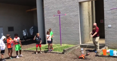 Kids participating in a science camp at the Franklin Institute celebrated the launch of Apollo 11 by making model rockets and then testing them out.