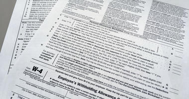 This Feb. 1, 2018 file photo shows an IRS W-4 form in New York. On Friday, May 31, 2019, the IRS is expected to release a proposed update to the form. Experts say that while it will be much more accurate, it will also be much more difficult.