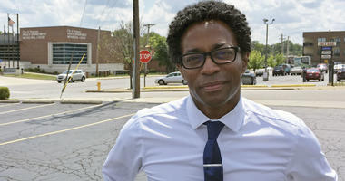 In this Aug. 8, 2018 photo, Wesley Bell stands outside the Ferguson, Mo., police headquarters a day after he defeated longtime St. Louis County prosecutor Bob McCulloch in the Democratic primary.