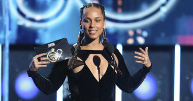 In this Jan. 28, 2018 file photo, Alicia Keys presents the award for record of the year at the 60th annual Grammy Awards at Madison Square Garden in New York.