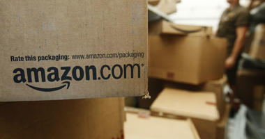 In this Oct. 18, 2010, file photo, an Amazon.com package awaits delivery from UPS in Palo Alto, Calif.