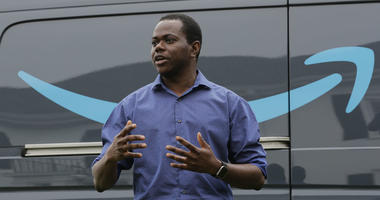 Olaoluwa Abimbola talks to reporters, Wednesday, June 27, 2018, in Seattle, at a media event for Amazon to announce a new program that lets entrepreneurs around the country launch businesses that deliver Amazon packages.