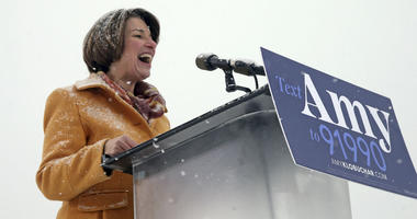 Democratic Sen. Amy Klobuchar, laughs as she addresses a snowy rally where she announced she is entering the race for president Sunday, Feb. 10, 2019, at Boom Island Park in Minneapolis.