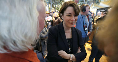 U.S. Sen. Amy Klobuchar, D-Minn., center, greets local residents during a meet and greet, Saturday, Feb. 16, 2019, in Mason City, Iowa.