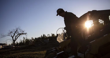 Tim Walters starts up equipment to clear debris while helping home owners whose house was destroyed by a tornado in Beauregard, Ala., Wednesday, March 6, 2019.