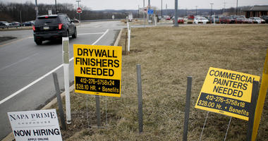 In this Friday, March 1, 2019, photo signs for employment opportunities are posted at an exit ramp off of Interstate 79 in Zelienople, Pa.