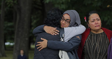 Mourners hug after paying their respects to the victims near the Masjid Al Noor mosque in Christchurch, New Zealand, Monday, March 18, 2019. A steady stream of mourners paid tribute at makeshift memorial to the 50 people slain by a gunman at two mosques i