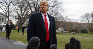 President Donald Trump listens to a question as he speaks with reporters before boarding Marine One on the South Lawn of the White House, Friday, March 22, 2019, in Washington.