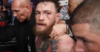 In this Oct. 6, 2018, file photo, Conor McGregor walks out of the arena after he was defeated by Khabib Nurmagomedov in a lightweight title mixed martial arts bout at UFC 229 in Las Vegas.