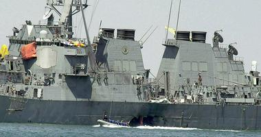 In this Oct. 15, 2000 file photo, experts in a speed boat examine the damaged hull of the USS Cole at the Yemeni port of Aden after an al-Qaida attack that killed 17 sailors.