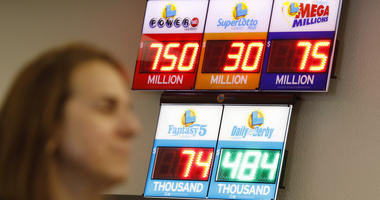 Jackpots, including the Powerball jackpot, are on display at the Lotto Store at Primm just inside the California border Wednesday, March 27, 2019, near Primm, Nev.