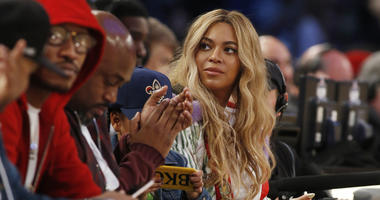 "FILE - In this Feb. 19, 2017. file photo, Beyonce sits at court side during the second half of the NBA All-Star basketball game in New Orleans. Netflix on Sunday, April 7, 2019 posted on its social media channels a yellow image with the word ""Homecoming"""
