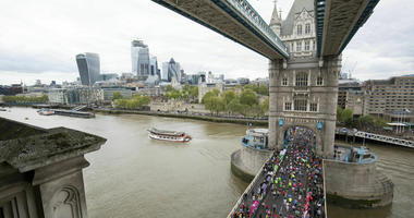 Runners take part in the 2019 London Marathon, over Tower Bridge in London, Sunday April 28, 2019.