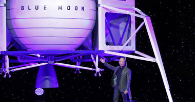 Jeff Bezos speaks in front of a model of Blue Origin's Blue Moon lunar lander, Thursday, May 9, 2019, in Washington.