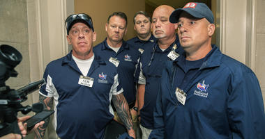 Sept. 11 first responders John Feal, left, Ret. Lt. Michael O'Connell, right, and other first responders speak to reporters as they leave the office of Senate Majority Leader Mitch McConnell, following their meeting at McConnell's office on Capitol Hill.